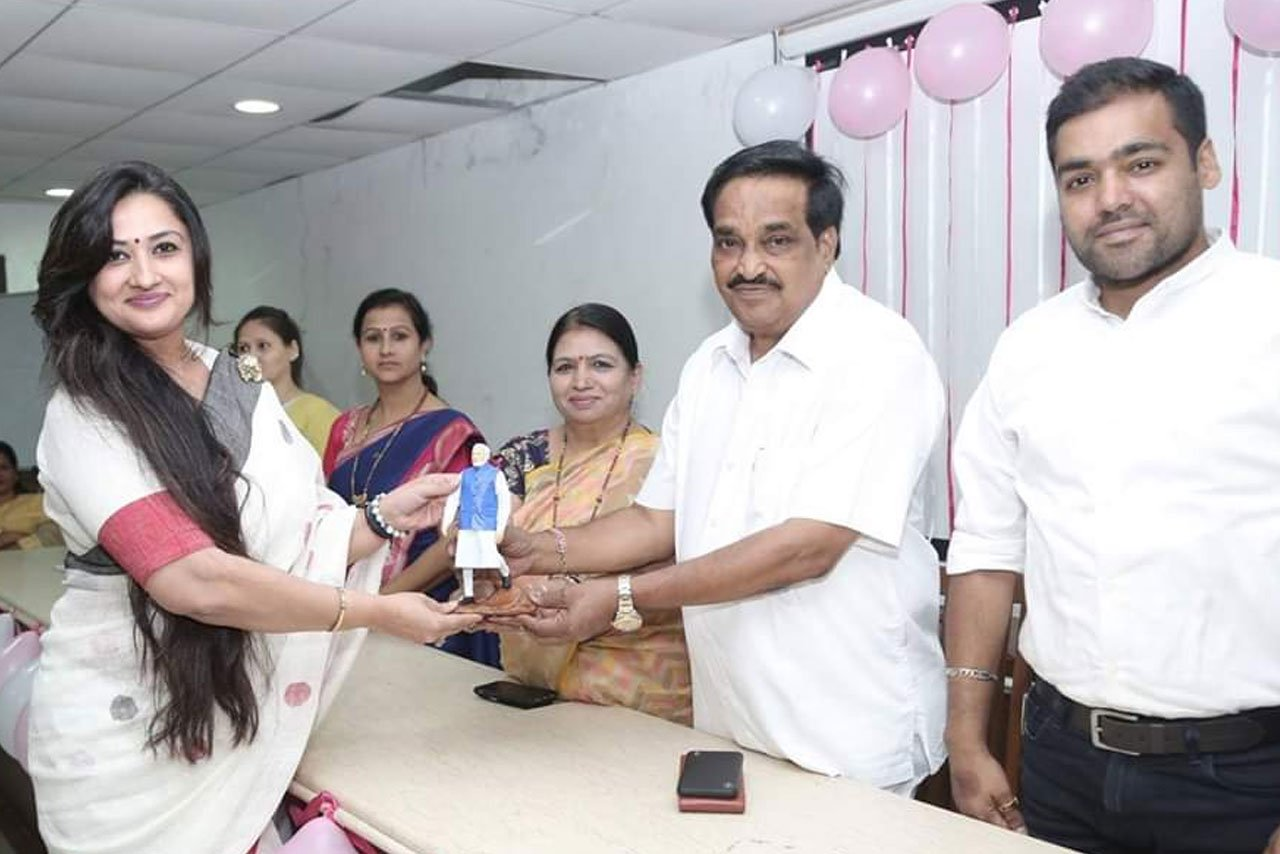 """Awarded as """"The most Influential Woman"""" by worthy hands of MP C.R.Patil"""